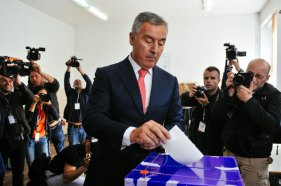 Montenegro's Prime Minister Milo Djukanovic casts his ballot during parliamentary elections at a polling station in Podgorica on October 16, 2016. Montenegro began voting in parliamentary elections on October 16, 2016 with opposition groups hoping to end the quarter-century rule of pro-Western premier Milo Djukanovic, who warns that his rivals would derail imminent NATO accession. / AFP PHOTO / SAVO PRELEVIC